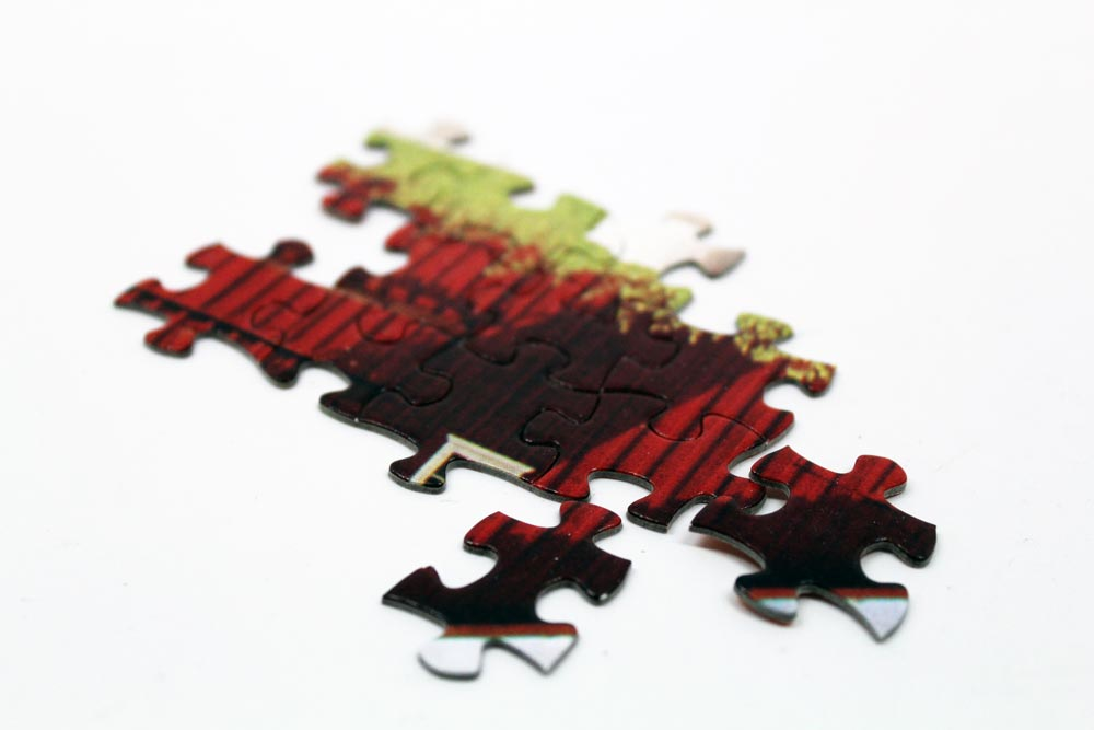 Design a jigsaw puzzle, interlocking-puzzle-pieces